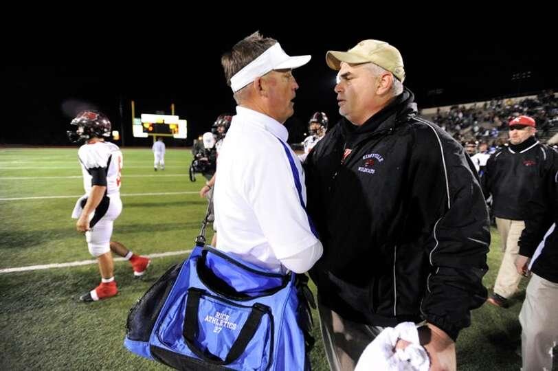 Rice Raiders coach, Brad Dumont, left, congratulates Kirbyville's  head coach, Jack Alverez, after t