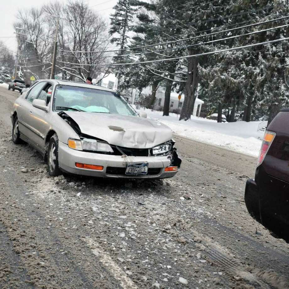 A two-car accident slowed traffic Tuesday morning on Western Avenue in Albany.   (John Carl D'Annibale / Times Union) Photo: John Carl D'Annibale / 10011776A
