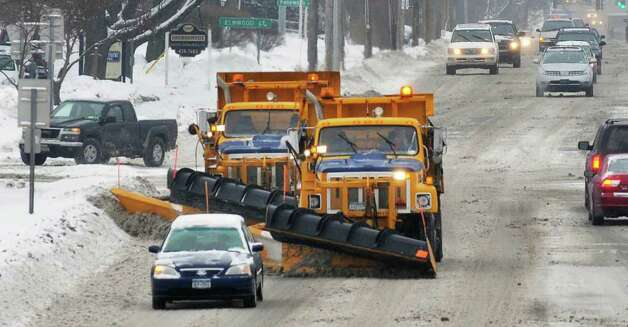State snowplows clear the westbound lanes of Route 20 Tuesday near Stuyvesant Plaza in Albany.   (John Carl D'Annibale / Times Union) Photo: John Carl D'Annibale / 10011776A