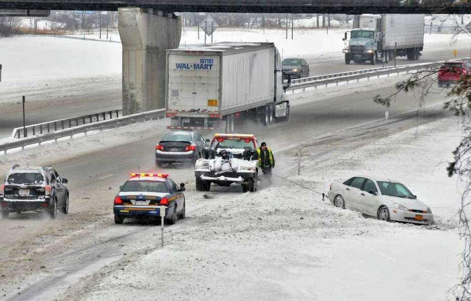 State Police and a tow truck at the scene of a vehicle spinout Tuesday morning in the southbound lane of the Thruway near Exit 24 in Albany. (John Carl D'Annibale / Times Union) Photo: John Carl D'Annibale / 10011776A