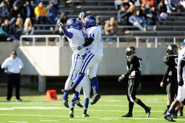 Bruins linebackers, Taylor Reed, left, and Adoirian Underwood, right celebrate  after stopping Pasadena Memorial during the second half of action at Stallworth Stadium in Baytown on Saturday, November 15, 2008.  Valentino Mauricio/The Enterprise