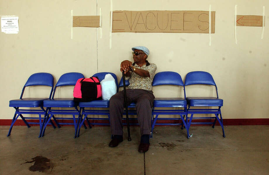 Albert lovett, 73, of Beaumont, waits for the next bus to depart for a shelter in San Antonio, Wednesday, Sept. 21, 2005, at Ford Park in Beaumont. The facility was a staging point for Hurricane Rita evacuees to be bussed out of the area as well as the command post for multiple government  agencies, including FEMA, the Texas military forces, the Red Cross and the Incident Management Team. Scott Eslinger/ Photo: THE ENTERPRISE
