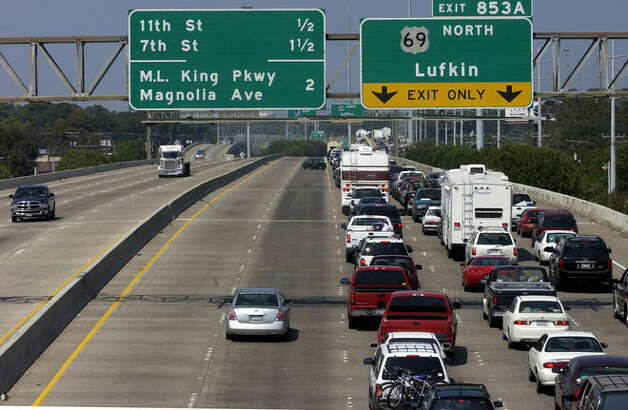 As traffic moves smoothly along Interstate10 southbound, cars, trucks, RVs, etc., wait in a long line northbound with some movement coming every few minutes on Sept. 22, 2005. Dave Ryan/ Photo: