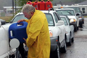 Pat Lemberger, 63, of Nacogdoches, poured fuel into his pick-up truck while waiting in a line of more than 20 cars to purchase more gas at a Nacogdoches gas station. Hurricane Rita evacuees depleted available gas in the area as they attempted to drive away from the storm's path and toward safe ground.