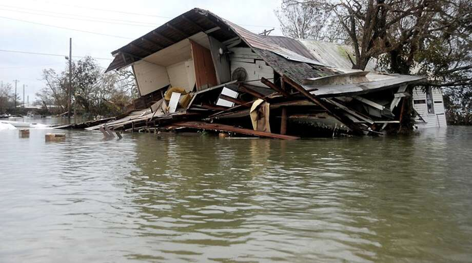 A home is  destroyed by wind and flood in  Sabine Pass, Sunday. Tammy McKinley/ Photo: THE ENTERPRISE