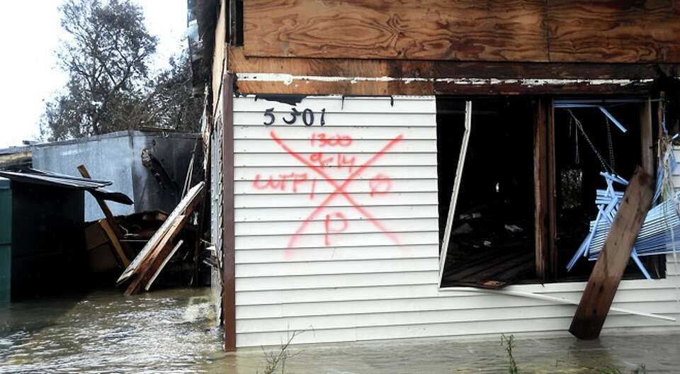 Marks left by rescue  worker on a house flooded in  Sabine Pass, Sunday.  Tammy McKinley/