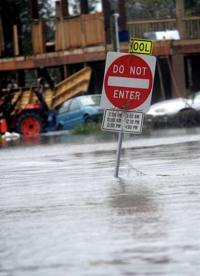 A  sign is  submerged in flood   water  in   Sabine Pass, Sunday. Tammy McKinley/
