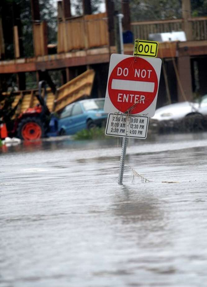 A  sign is  submerged in flood   water  in   Sabine Pass, Sunday. Tammy McKinley/ Photo: THE ENTERPRISE