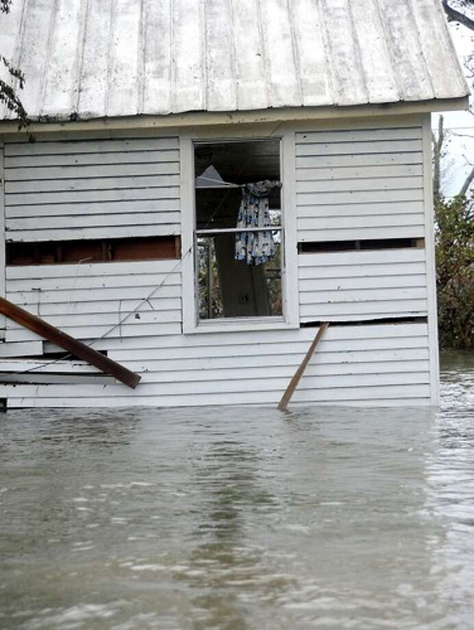 A home is  flooded in   Sabine Pass, Sunday. Tammy McKinley/ Photo: THE ENTERPRISE