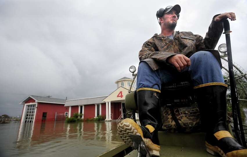 Bobby England  surveys  the damage in  Sabine Pass, Sunday. Tammy McKinley/