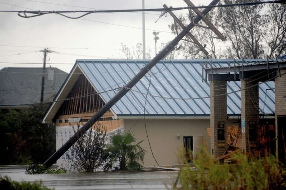 Hurricane Ike damaged several buildings  in   Sabine Pass, Sunday. Tammy McKinley/ Photo: THE ENTERPRISE