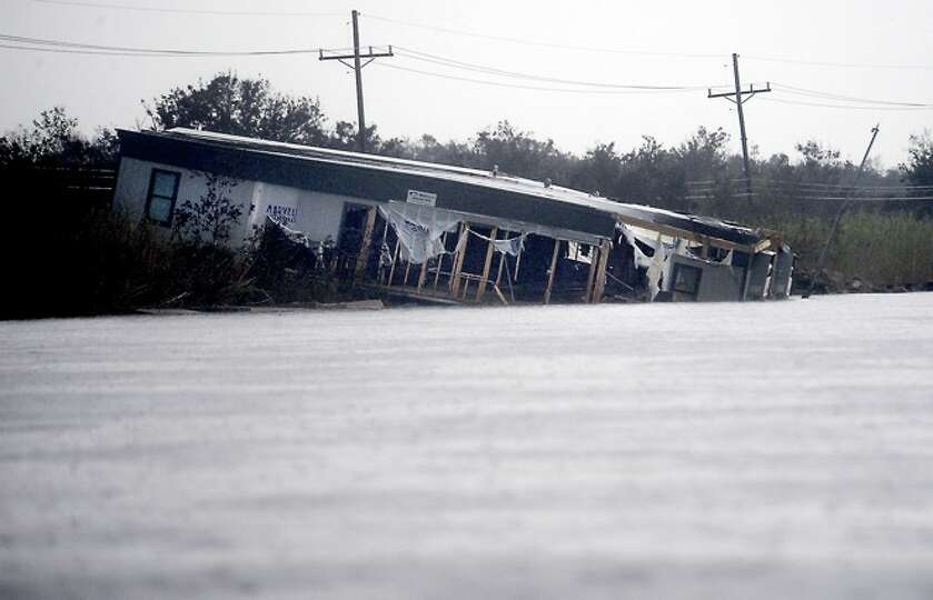 A mobile home is  moved into flooded  waters in  Sabine Pass, Sunday. Tammy McKinley/