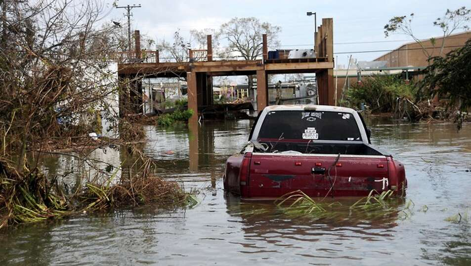 Flood  water inundates the  street in  Sabine Pass, Sunday.  Tammy McKinley/
