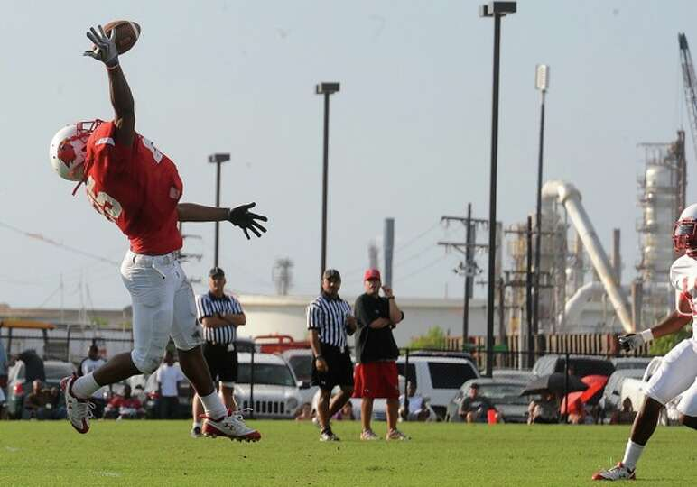 Lamar football players scrimmage each other on the Coach Vernon Glass Field of Champions on Monday.