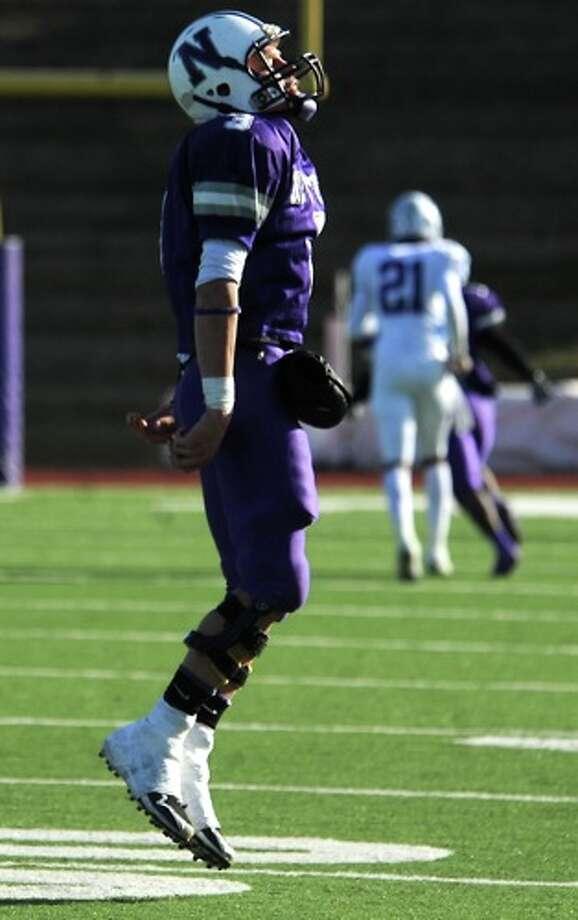 Newton's Halston Flanigan celebrates a Newton touchdown against Dangerfield at the Homer Bryce Stadium at Stephen F. Austin University in Nacogdoches, Saturday. Photo: TAMMY MCKINLEY