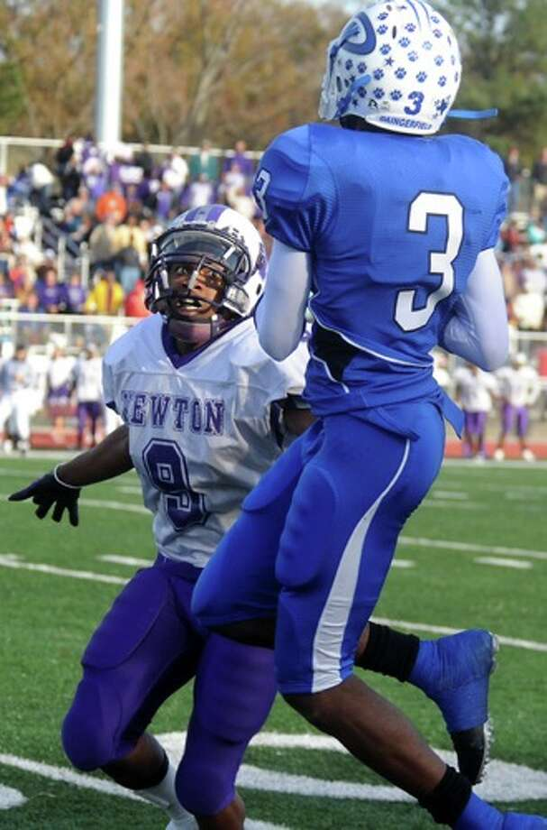 Daingerfield's Chris Jones goes up for the catch as Newton's Delenta Shankle goes for the tackle at Carthage High School in Carthage, Saturday. Photo: TAMMY McKINLEY