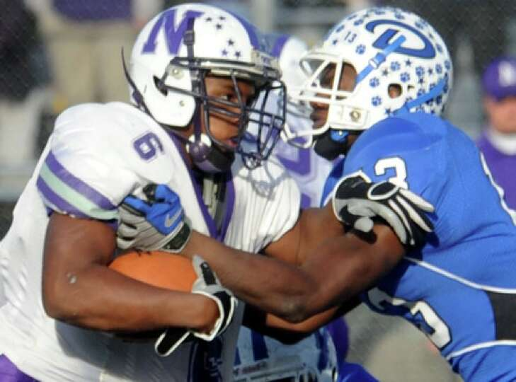 Newton's LaRay Alfred tries to gain yardage as Daingerfield's Julius Hurndon tries to stop him at Ca
