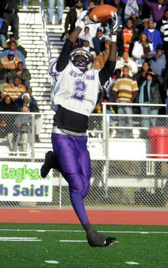 Newton's JaCobey Ross catches a pass and runs for a touchdown during the second half of the game aga