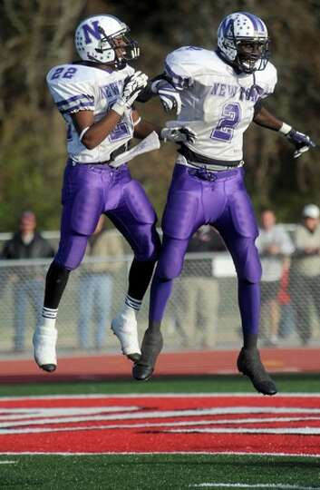 Newton's Stephen Alfred and JaCobey Ross celebrate Ross' touchdown at Carthage High School in Cartha