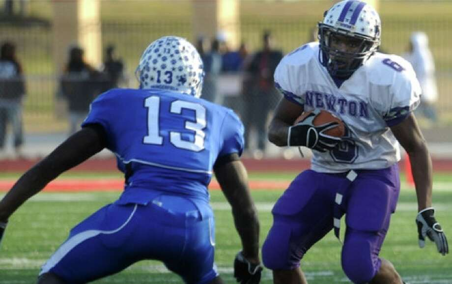 Newton's LaRAy Alfred tries to get around Dangerfield's Julius Hurndon at Carthage High School in Carthage, Saturday. Photo: TAMMY McKINLEY