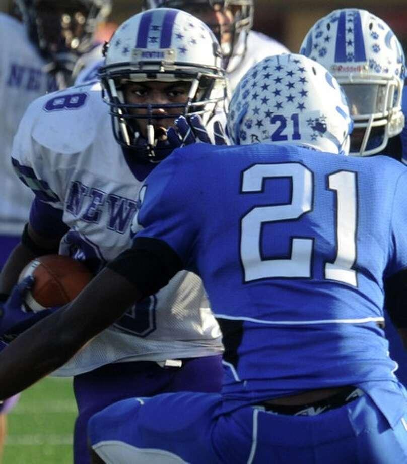 Newton's Kelvin Bennett tries to get past Daingerfield's Garrett Hughes at Carthage High School in Carthage, Saturday. Photo: TAMMY McKINLEY