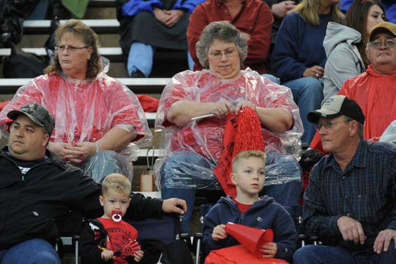 Kirbyville fans, Debbie Brown, left, and her sister, Ann Gilbert, right, are ready for the rain as t