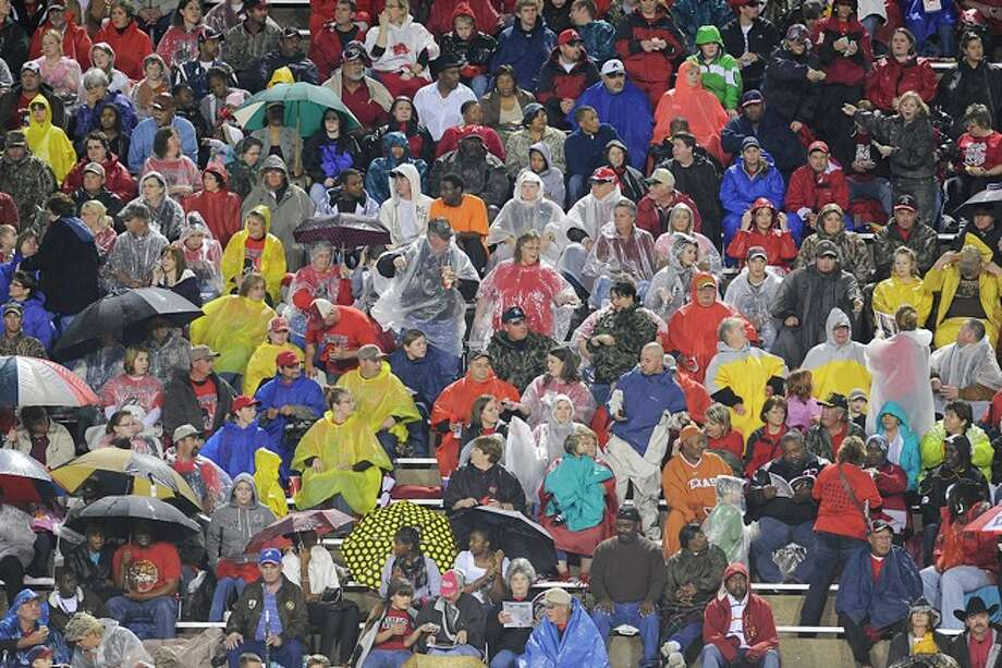 Kirbyville fans didn't let the weather stop them from traveling to Lufkin to cheer their team on to victory Friday night against the Arp Tigers  at Abe Martin Stadium. November 28, 2008. Photo: VALENTINO MAURICIO