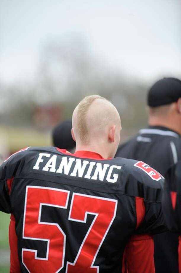 Kirbyville's Cody Fanning and other players displayed new hair cuts during warm ups before taking on Pilot Point in the Class 2A Division I title game at Texas State University in San Marcos. Saturday, December 12, 2009. Photo: VALENTINO MAURICIO