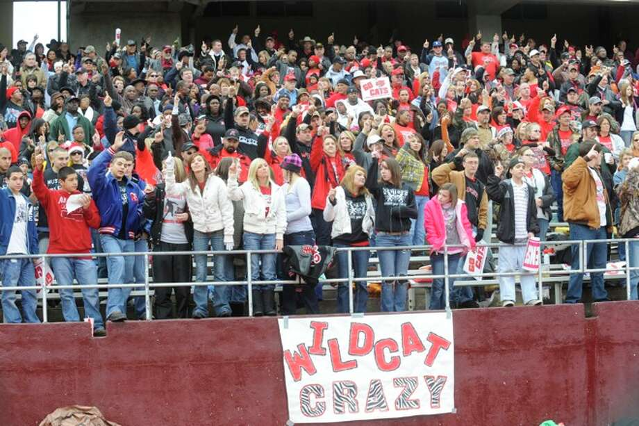 Kirbyville fans welcome the Wildcats on to the field at Bobcat Stadium for the Class 2A Division I title game against Pilot Point at Texas State University in San Marcos. Saturday, December 12, 2009. Photo: VALENTINO MAURICIO