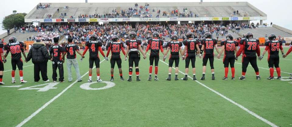 The Kirbyville Wildcats unite on the field before the start of their game against Pilot Point in the