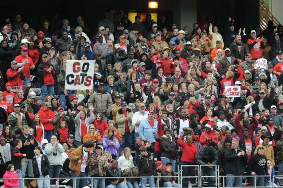 Kirbyville fans cheer the Wildcats on at Bobcat Stadium during the Class 2A Division I title game against Pilot Point at Texas State University in San Marcos. Saturday, December 12, 2009. Photo: VALENTINO MAURICIO