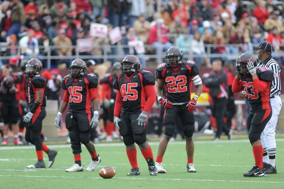 The Kirbyville defense waits for the Pilot Point offense at the line of scrimmage during first half action in the Class 2A Division I title game at Texas State University in San Marcos. Saturday, December 12, 2009. Photo: VALENTINO MAURICIO