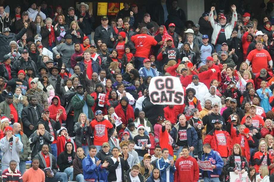 Kirbyville fans cheer the Wildcats on during the first half at Bobcat Stadium during the Class 2A Division I title game against Pilot Point at Texas State University in San Marcos. Saturday, December 12, 2009. Photo: VALENTINO MAURICIO