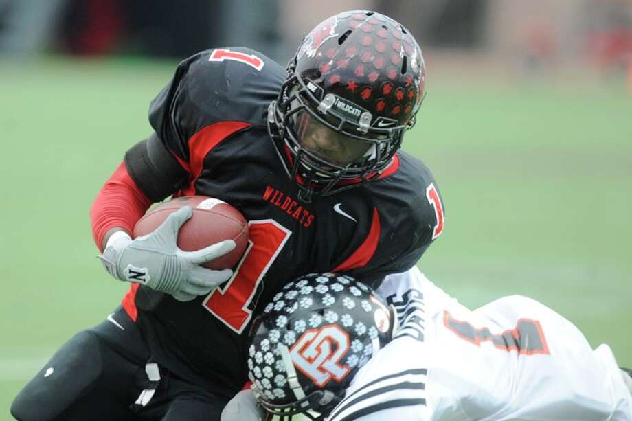 Kirbyville running back LeFredrick Ford rushes for a 14 yard touchdown in the first half against Pilot Point in Class 2A Division I State Championship action in Bobcat Stadium at Texas State University in San Marcos. Saturday, December 12, 2009. Photo: VALENTINO MAURICIO