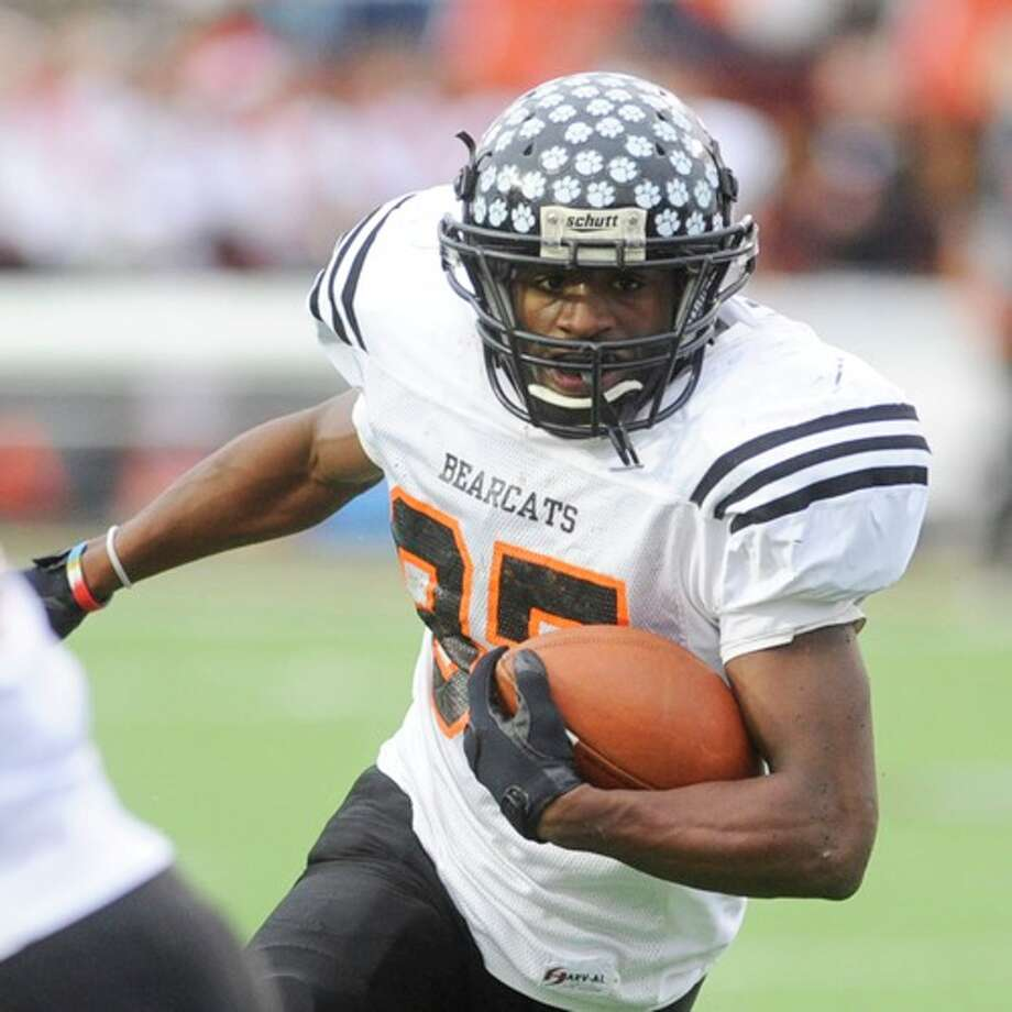 Pilot Point running back Jarman Johnson picks up yardage on a carry in the first half against Kirbyville during the Class 2A Division I title game at Texas State University in San Marcos. Johnson had 245 yards and two touchdowns on the day against the Wildcats. Saturday, December 12, 2009. Photo: VALENTINO MAURICIO