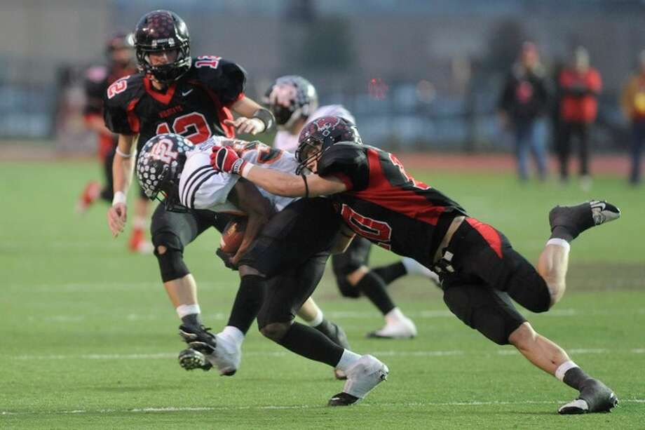 Kirbyville's Kael Jones (12) and Justin Keene (10) try to stop Pilot Point running back Jarman Johnson on a carry in second half action during the Class 2A Division I title game at Texas State University in San Marcos. Saturday, December 12, 2009. Photo: VALENTINO MAURICIO