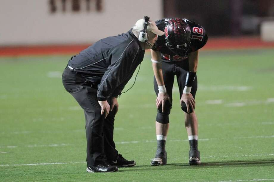 Kirbyville head coach Jack Alvarez, left, talks with quarterback Kael Jones in the final minutes of the fourth quarter against Pilot Point in the Class 2A Division I title game at Texas State University in San Marcos. Saturday, December 12, 2009. Photo: VALENTINO MAURICIO