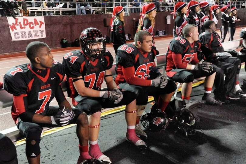 Kirbyville players watch from the bench during the final moments of their 35-18 loss to Pilot Point