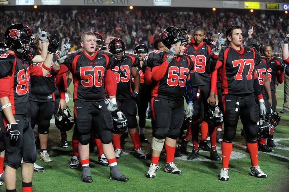 Kirbyville players stand for their school song after the Wildcats 35-18 loss to Pilot Point in the Class 2A Division I State Championship in Bobcat Stadium at Texas State University in San Marcos. Photo: VALENTINO MAURICIO