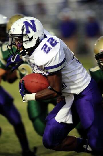 Newton's Stephen Alfred runs the ball against East Chambers in a match up at the Buccaneers' stadium