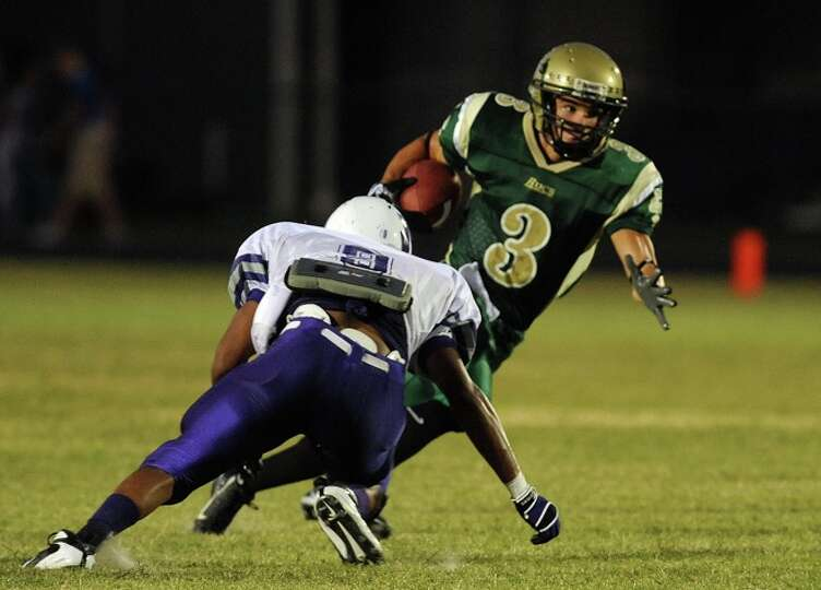 East Chamber's Anthony Ortiz runs the ball against Newton in a match up at the Buccaneers' new stadi
