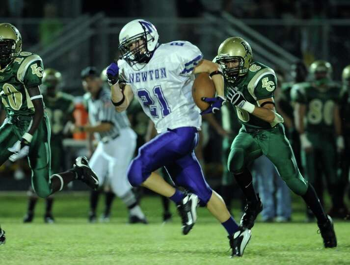 Newton's James Burch runs the ball against East Chambers in a match up at the Buccaneers' stadium Fr