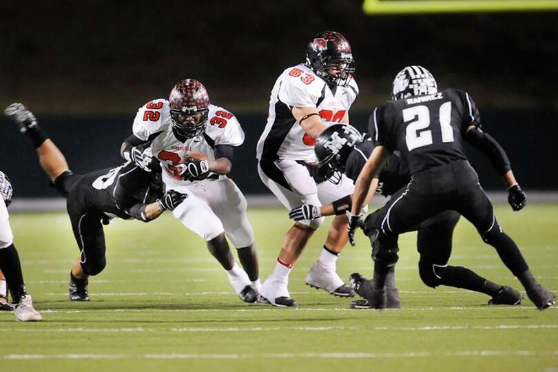 Wildcats running back, Broderick Jackson, blasts through the Muleshoe defense in the first half of t