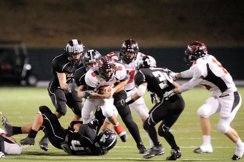 Kirbyville Wildcats quarterback, Aaron Hazelwood, is brought down by the Muleshoe defense in the sec