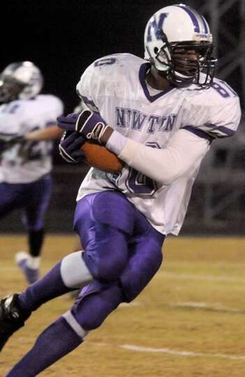 Newton's Ken Hunter makes the catch and runs for several yards during the game against East Chambers