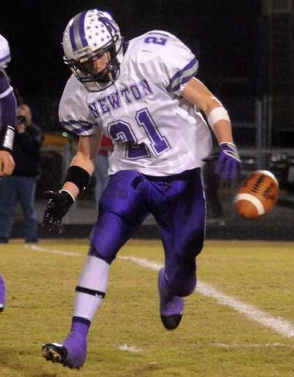 Newton's James Burch fumbles a hand off but quickly recovers during the game against East Chambers a
