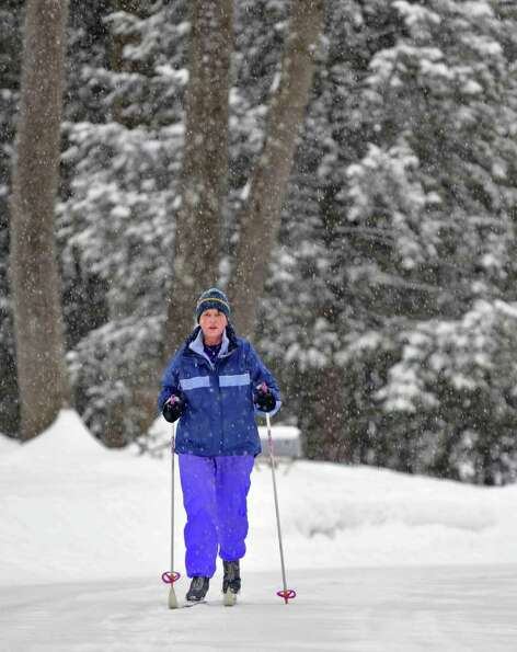 Barbara Roach skis through her Clifton Park neighborhood Tuesday morning.  (John Carl D'Annibale / T