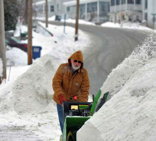 Herman Bauer uses a snowblower Tuesday in front of his Mansion Street home in Coxsackie. ( Philip Kamrass / Times Union ) Photo: Philip Kamrass