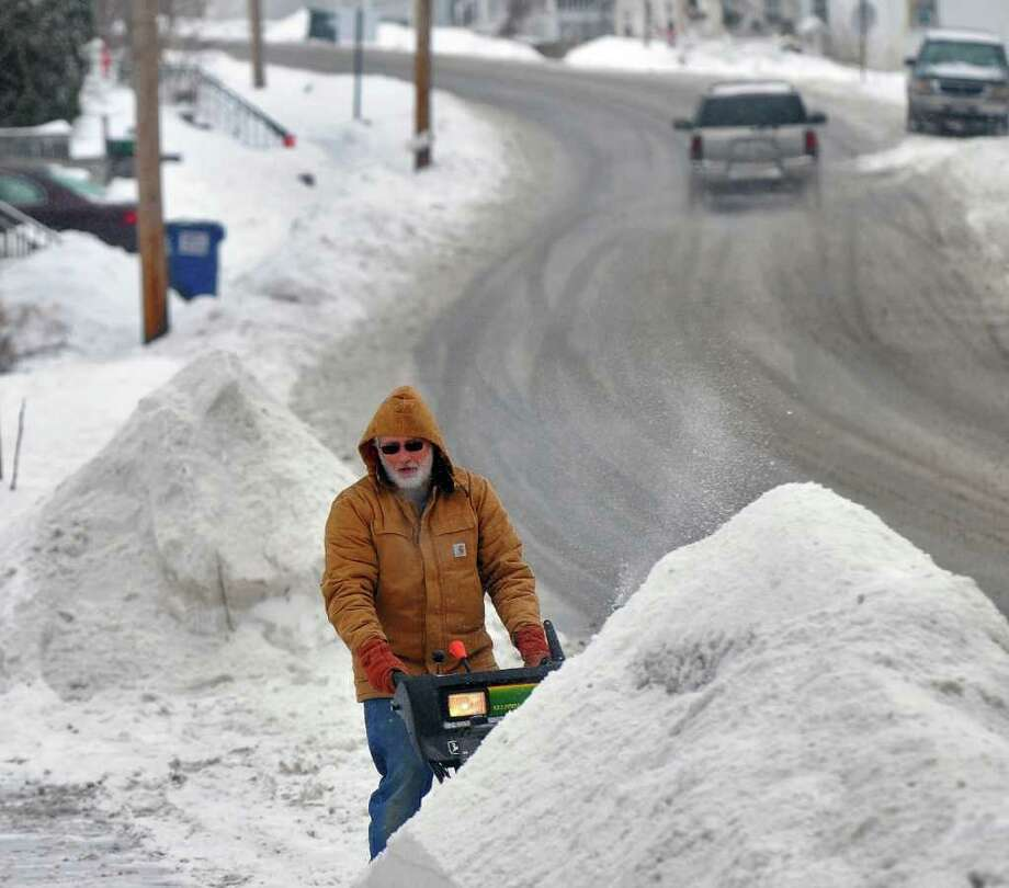 Herman Bauer uses a snowblower in front of his Mansion Street home Tuesday in Coxsackie. ( Philip Kamrass / Times Union ) Photo: Philip Kamrass
