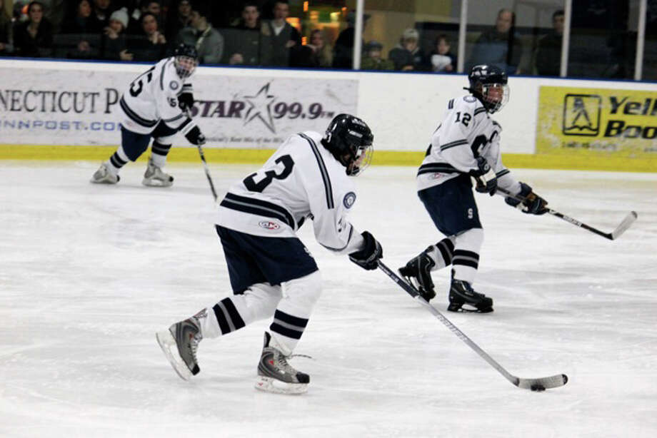 From left, junior captains Kyle Wehmhoff and Aaron Liu and senior captain Tali Laifer have been an explosive first line for the 6-2 Wreckers. Liu and Laifer each had goals and Wehmhoff had two assists on Saturday in a 4-3 loss to St. Joseph. Photo: Contributed Photo / Anna Andriuk